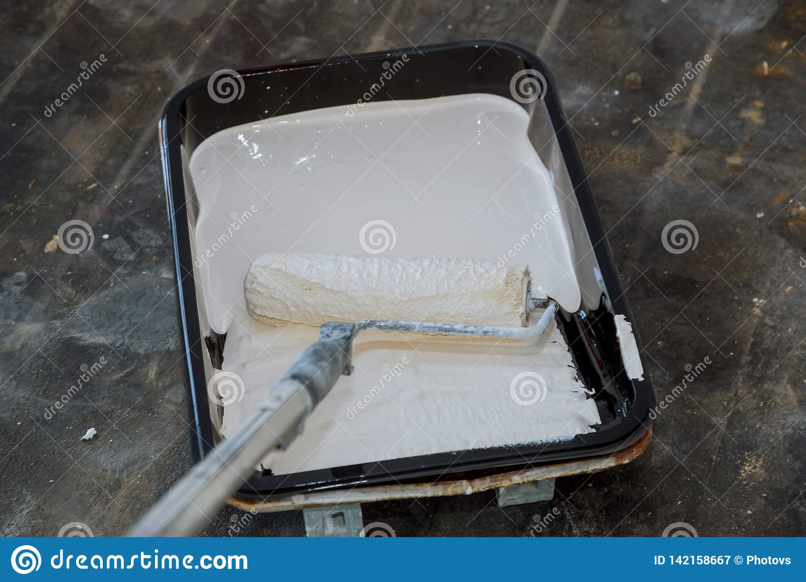 Realistic Paint Tray And Roller On Drop Cloth During Interior