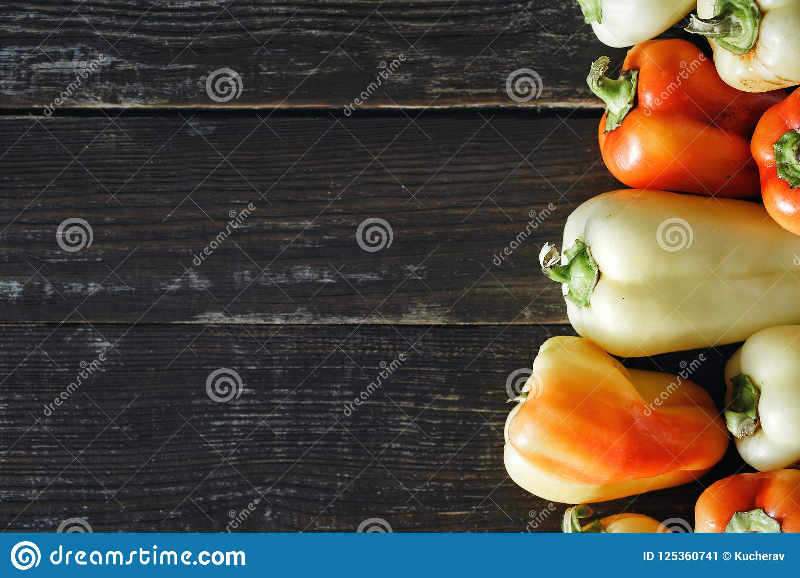Set red yellow homemade pepper dark background border top view
