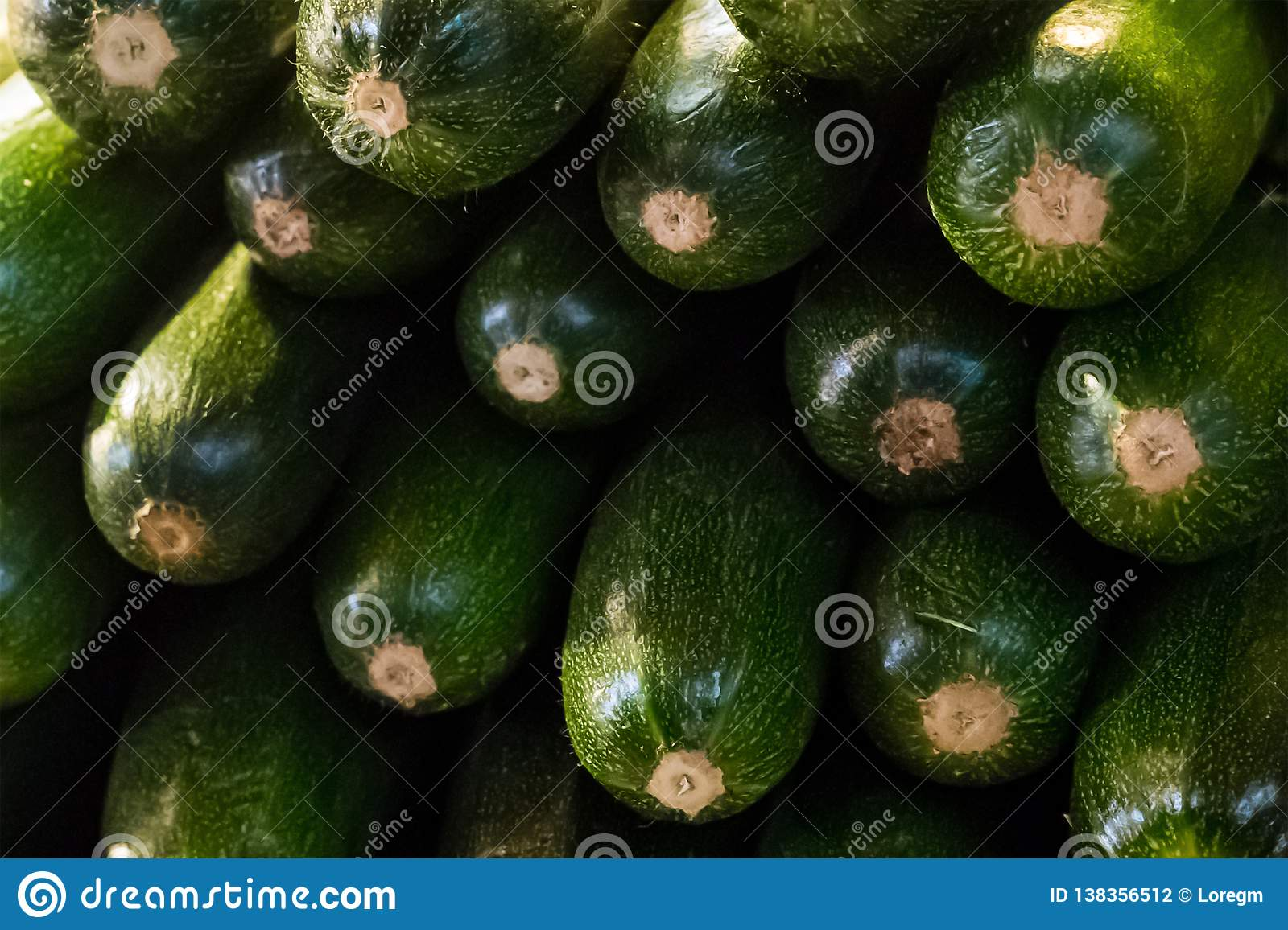 Set row of zucchini green fresh mature vegetables long fruits green dark end stack ingredient stew background backing