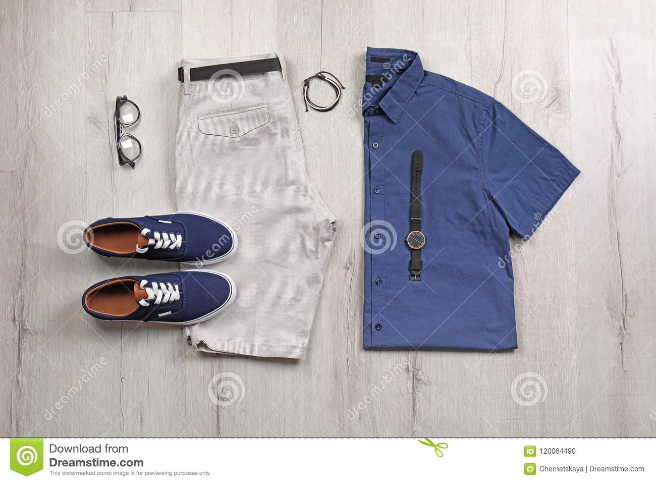 Set Of Stylish Clothes And Accessories On Wooden Floor Stock Photo