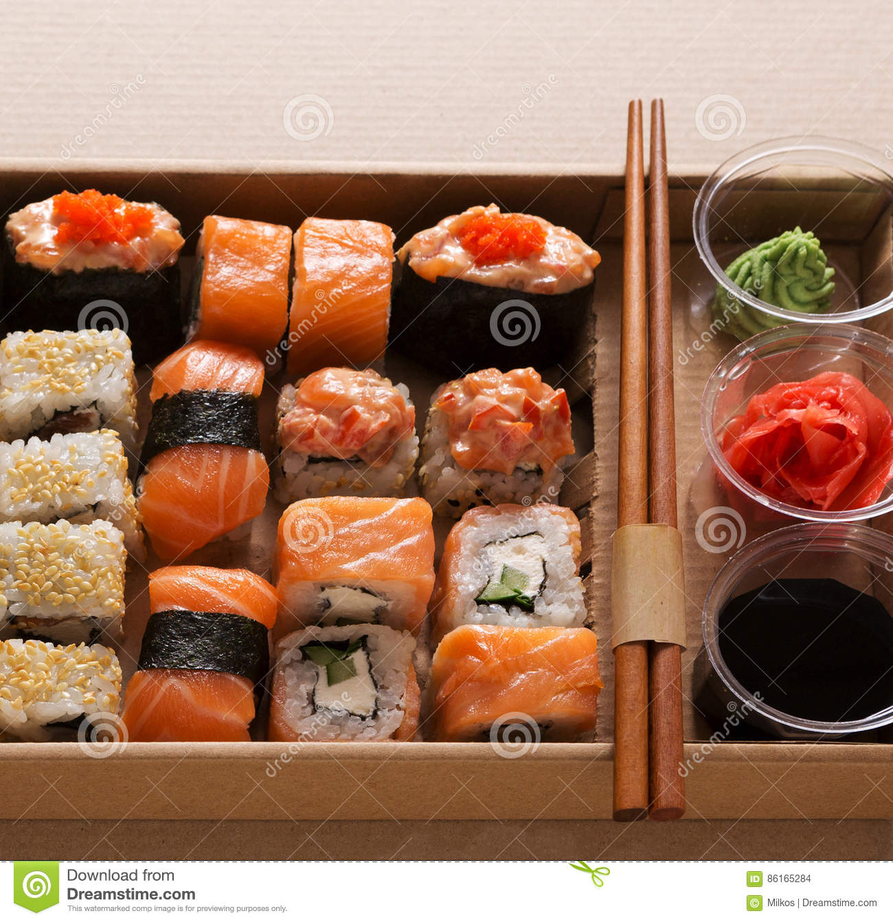 Set of sushi maki and rolls closeup in carton delivery box for Asian cuisine delivery