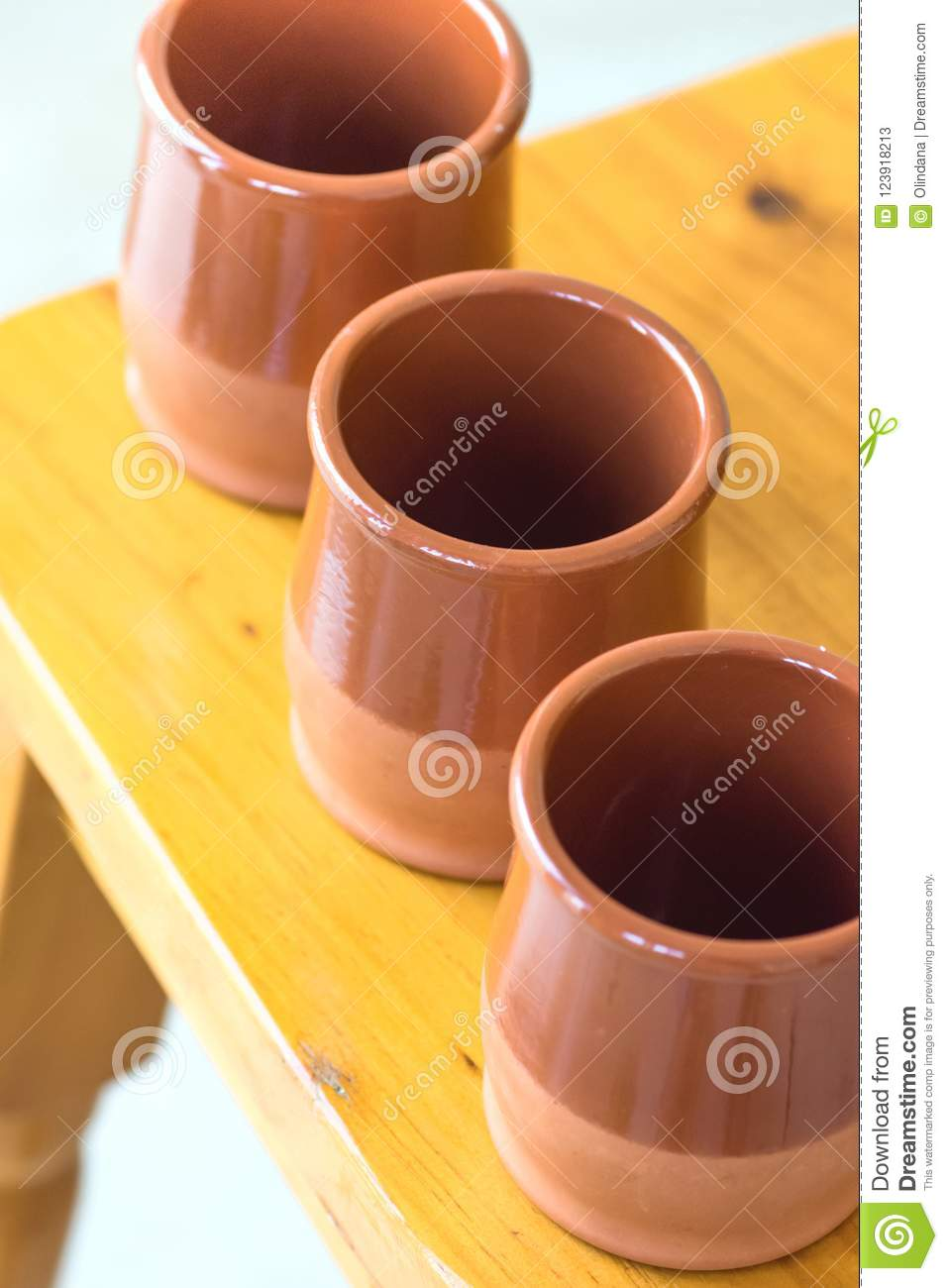 Set Of Traditional Spanish Red Clay Glazed Earthenware Cups On Wooden Table Mediterranean Kitchen Interior Decoration Style Stock Image Image Of Ceramics Earthenware 123918213