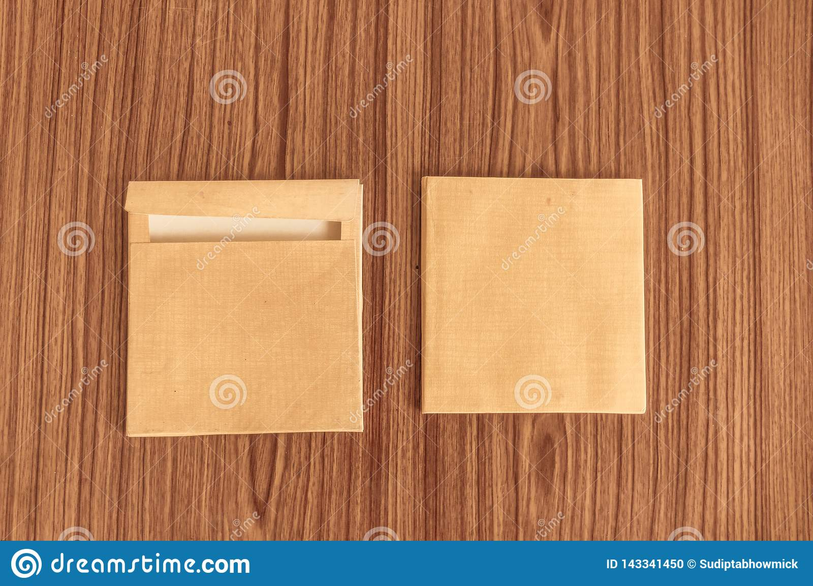 Set of two Brown envelope front and back isolated on wooden table hardwood floor background. Business cards blank. Mockup. Top