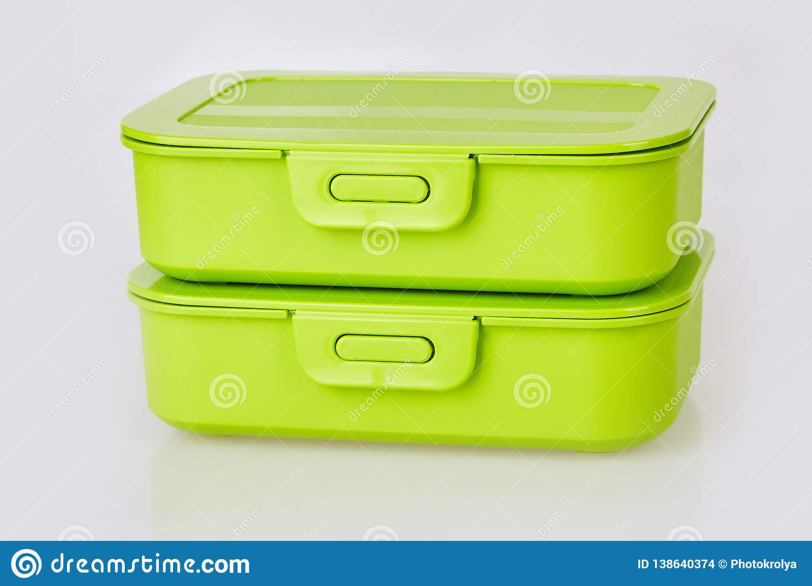 Set of two similar green plastic food storage containers