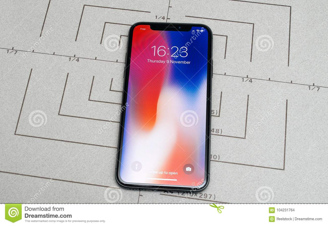 Paris, France - Nov 9, 2017: new Apple iPhone X 10 smartphone screen after unboxing and testing with the iconic wallpaper