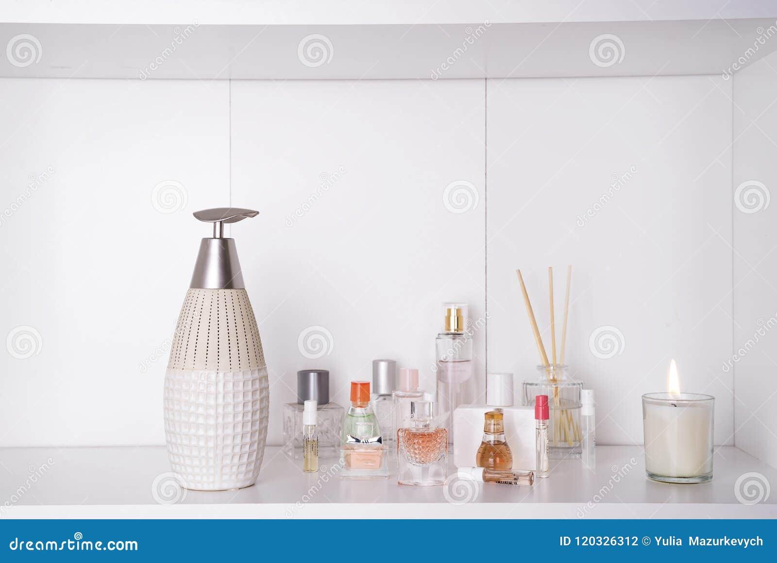 Set of various woman perfumes o white background. Aromatherapy SPA set