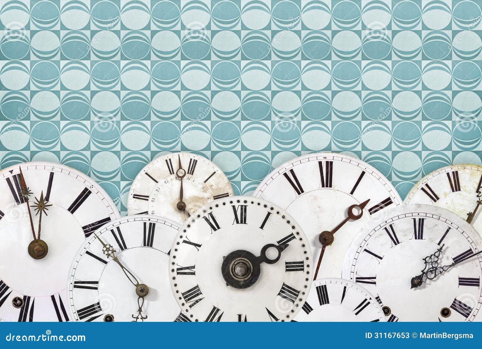 Set Of Vintage Clock Faces Against A Retro Wallpaper ...