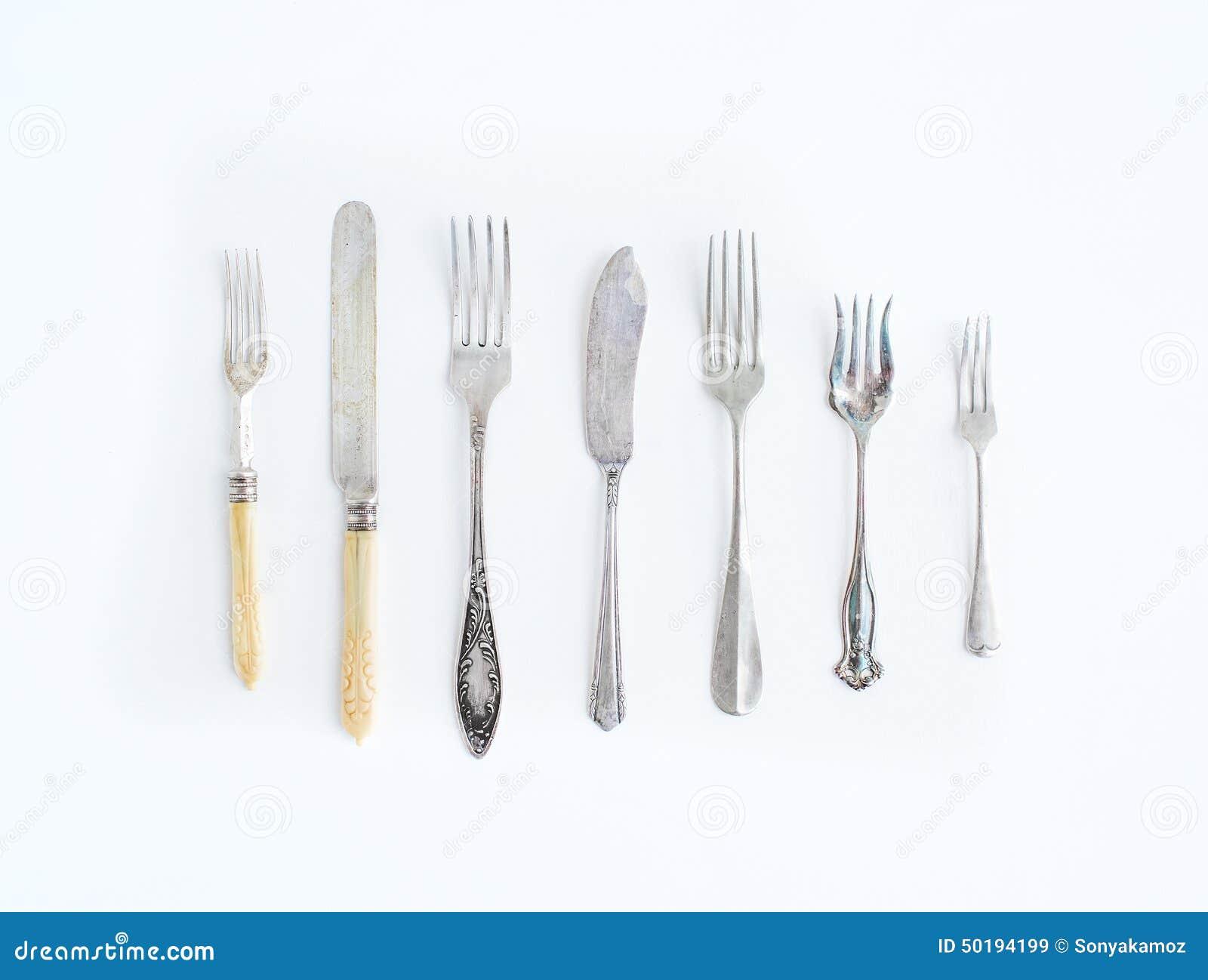 A Set Of Vintage Dining Knifes And Forks Of Different