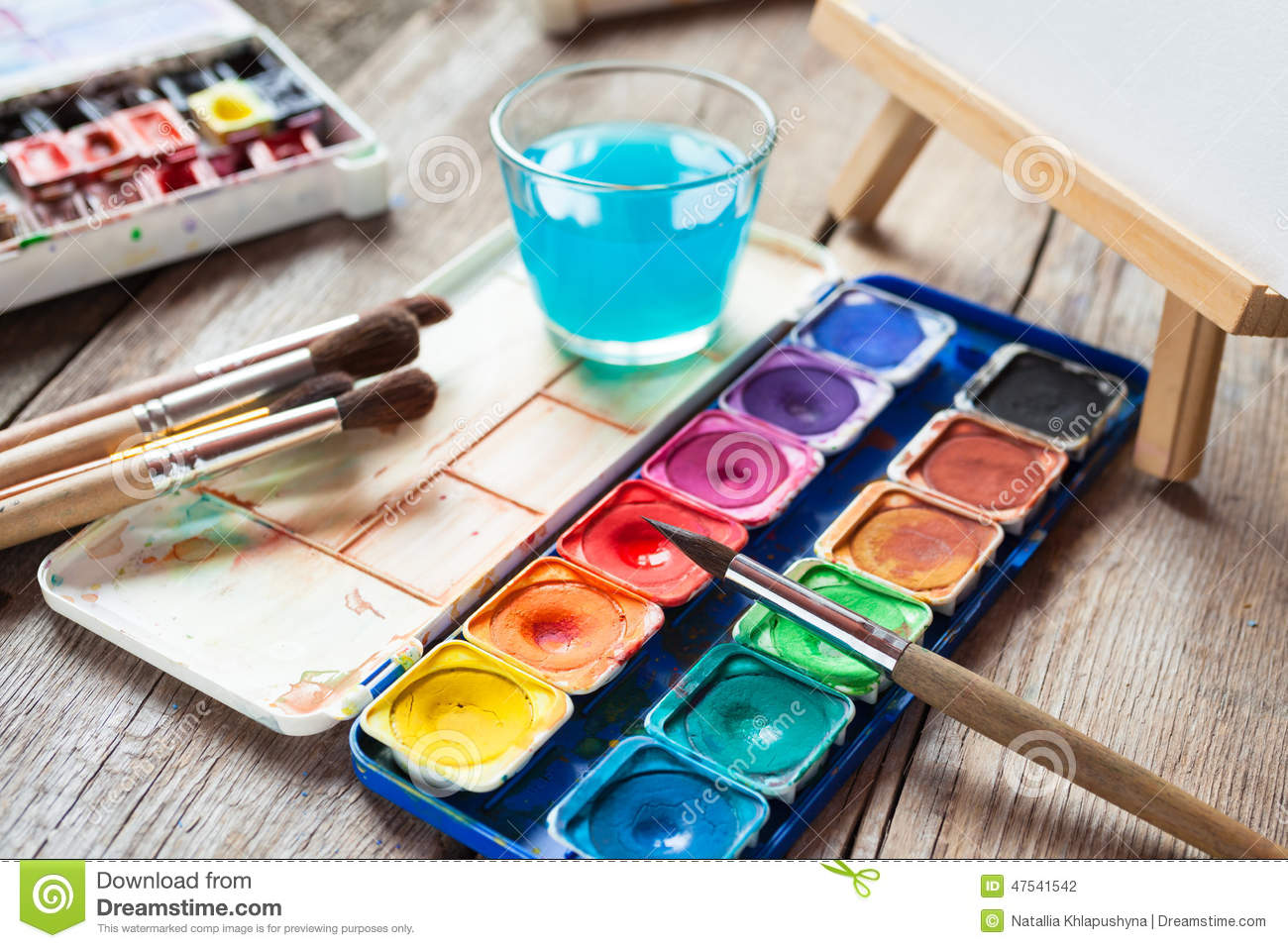 Set of watercolor paints art brushes glass of water and for Homedepot colorsmartbybehr com paintstore