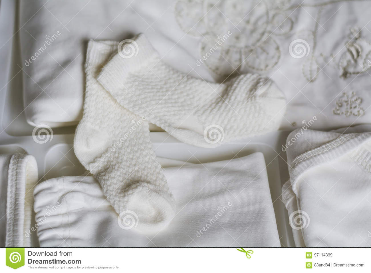 Set of white baby clothes