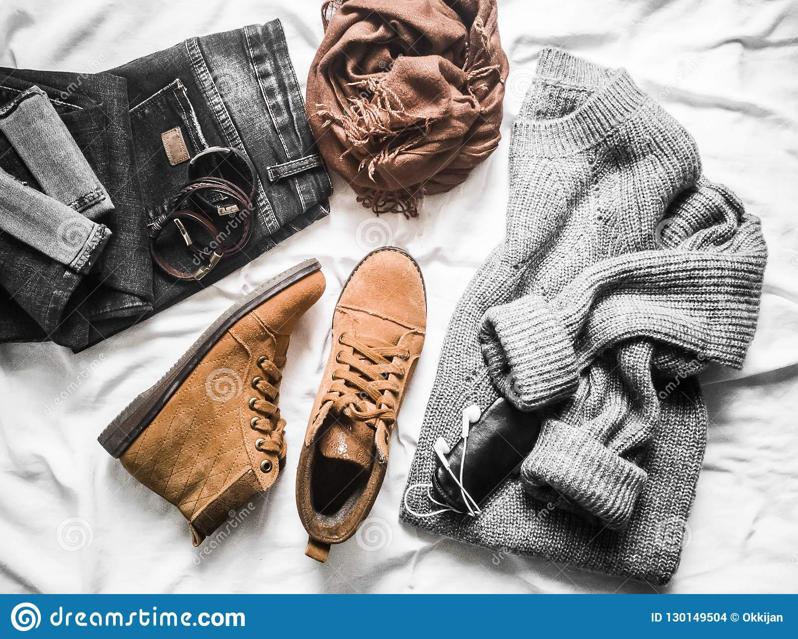 Set of women`s outfits autumn, winter clothes - jeans, gray pullover oversize, suede brown boots. Fashionable casual clothes for