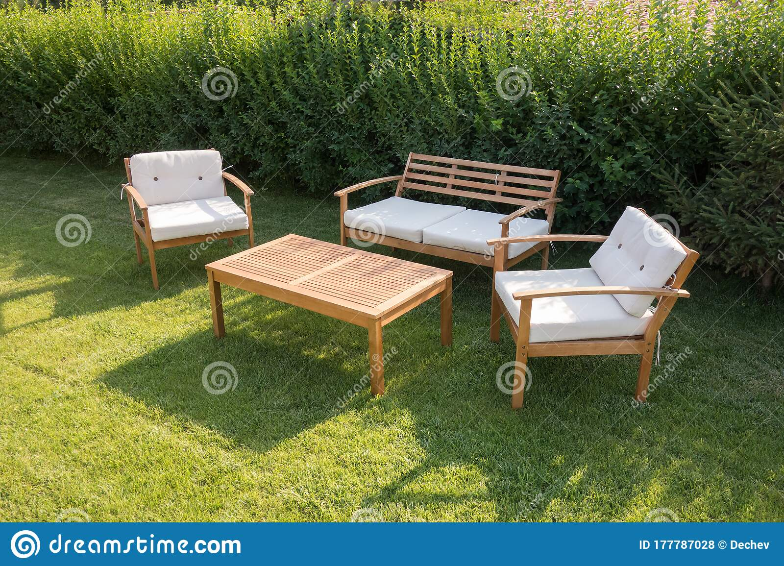 Set Of Wooden Garden Furniture. Table And Chairs With Pillows At