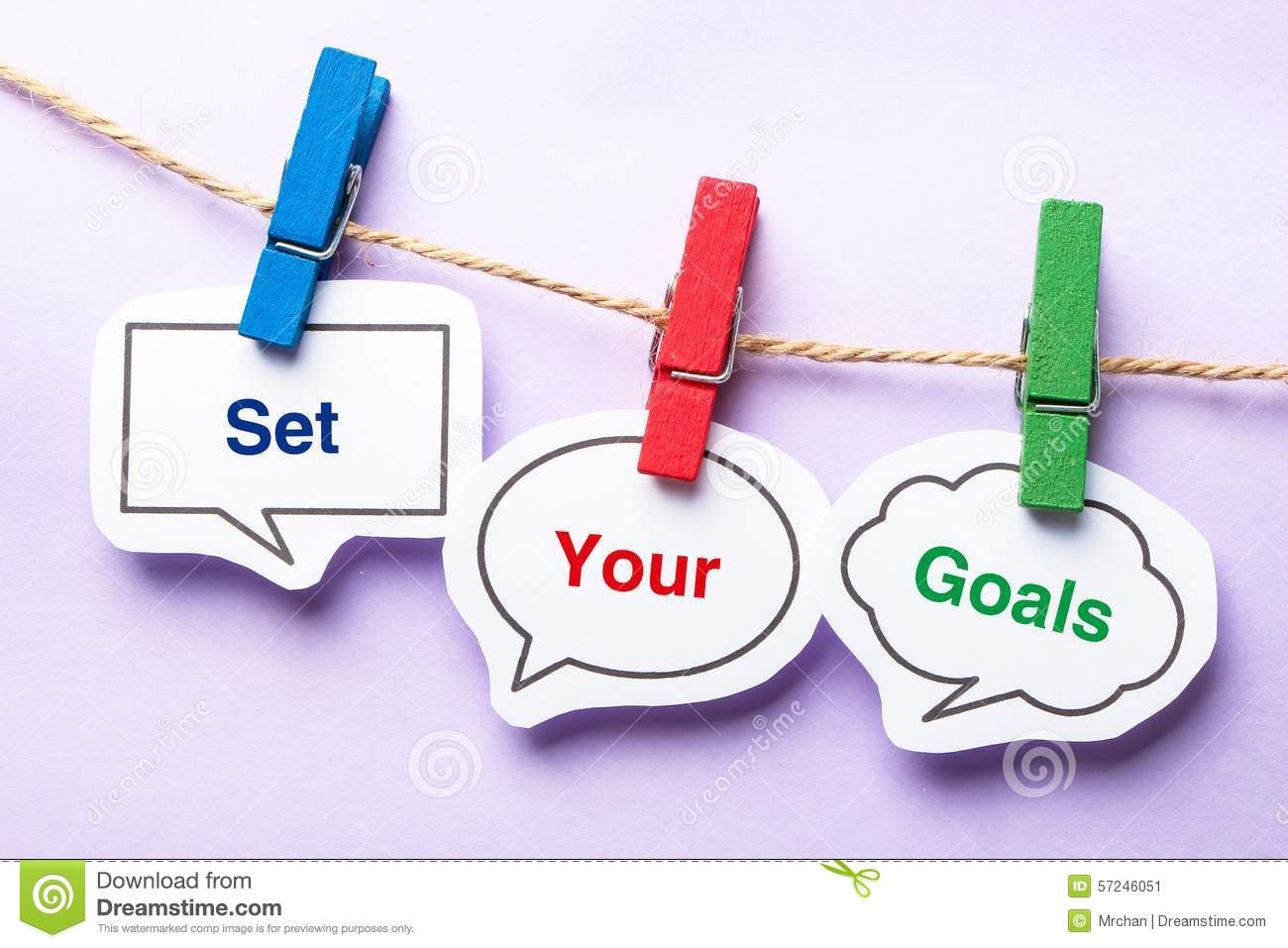 Set your goals paper bubbles with clip hanging on the line against ...