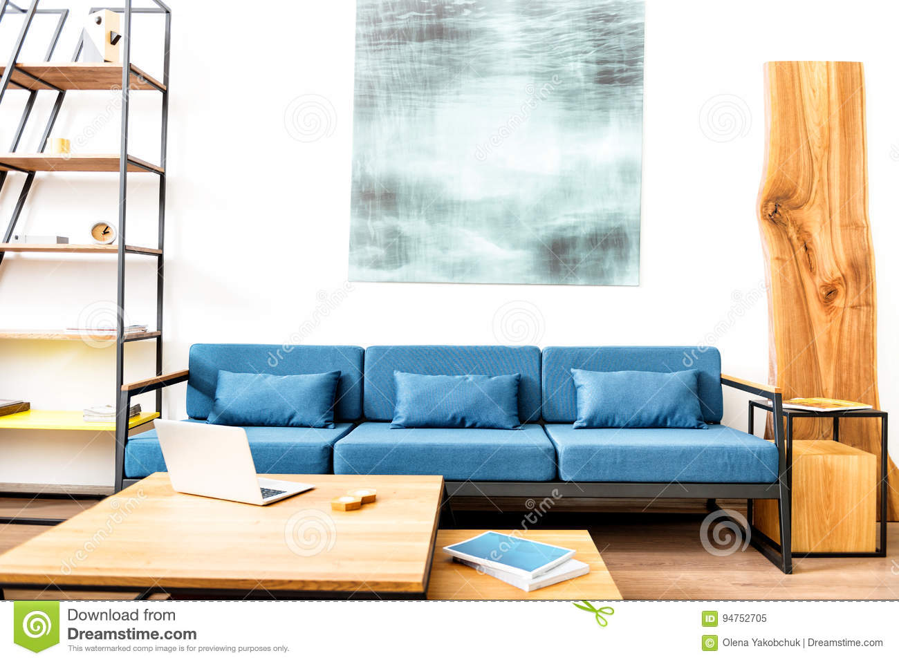 Settee With Image Above And Bookcase In Room