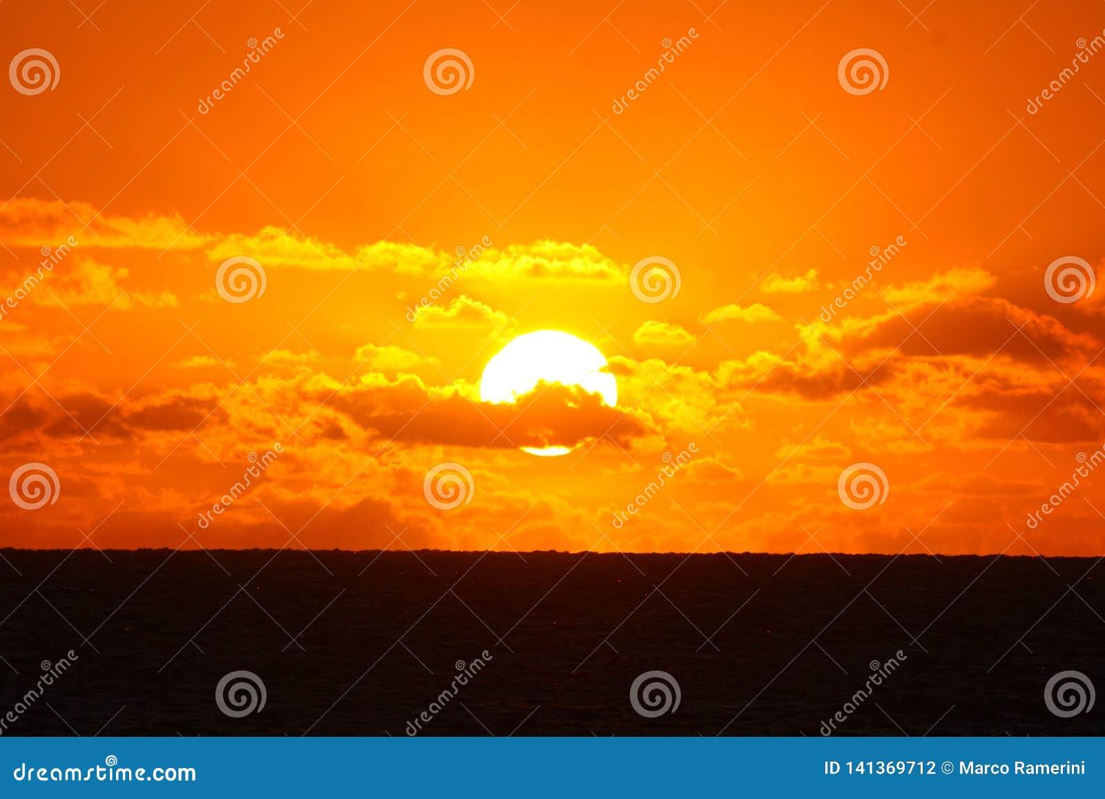 The setting sun on the sea in a tropical island, Fiji