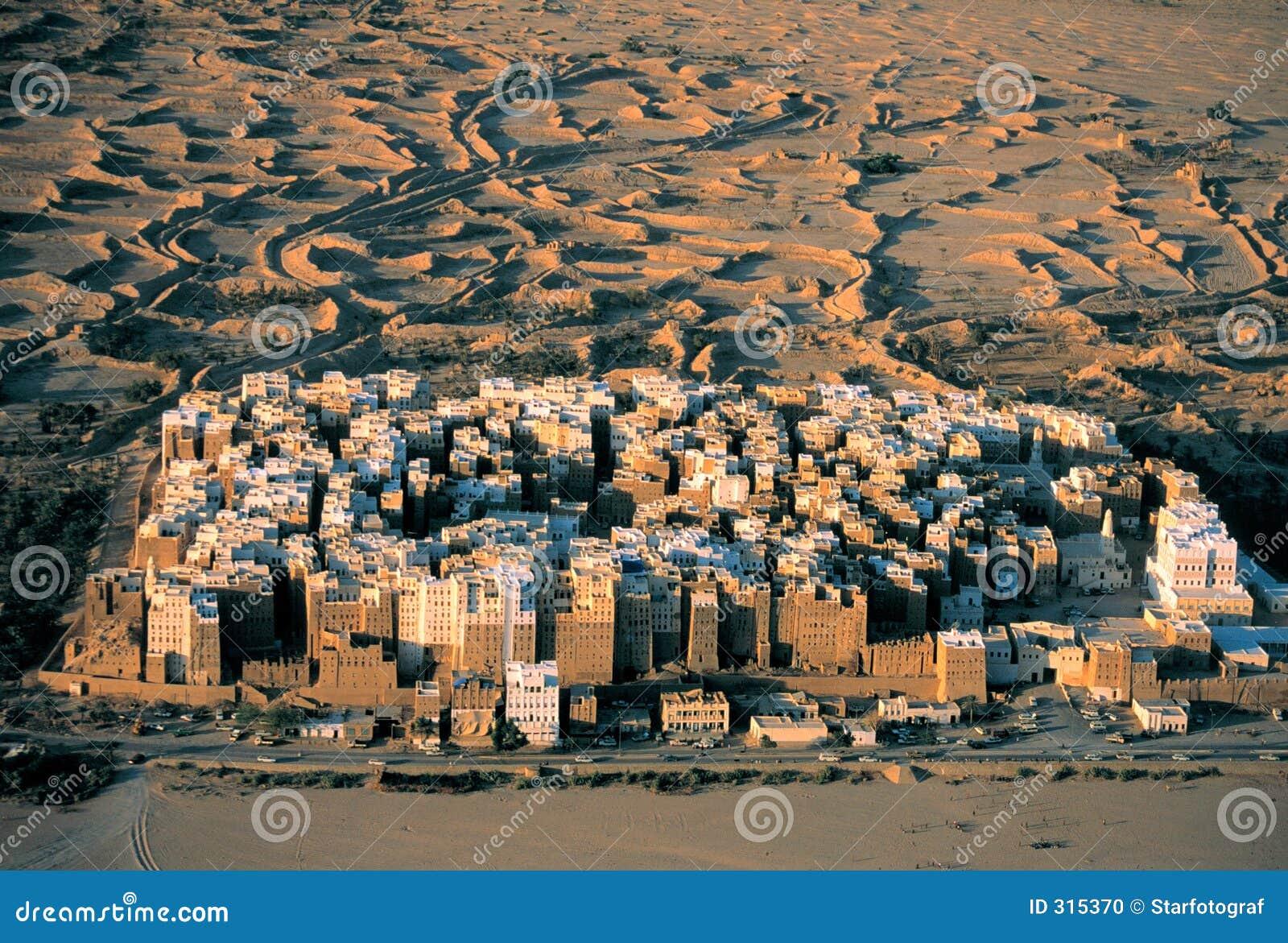 Settlement in the desert, bird's eye view, grainy film scan.