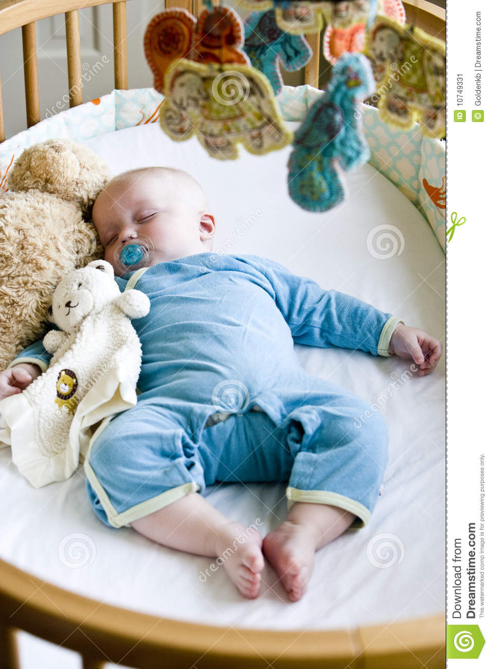 Seven Month Old Baby Boy Sound Asleep In His Crib Stock ...