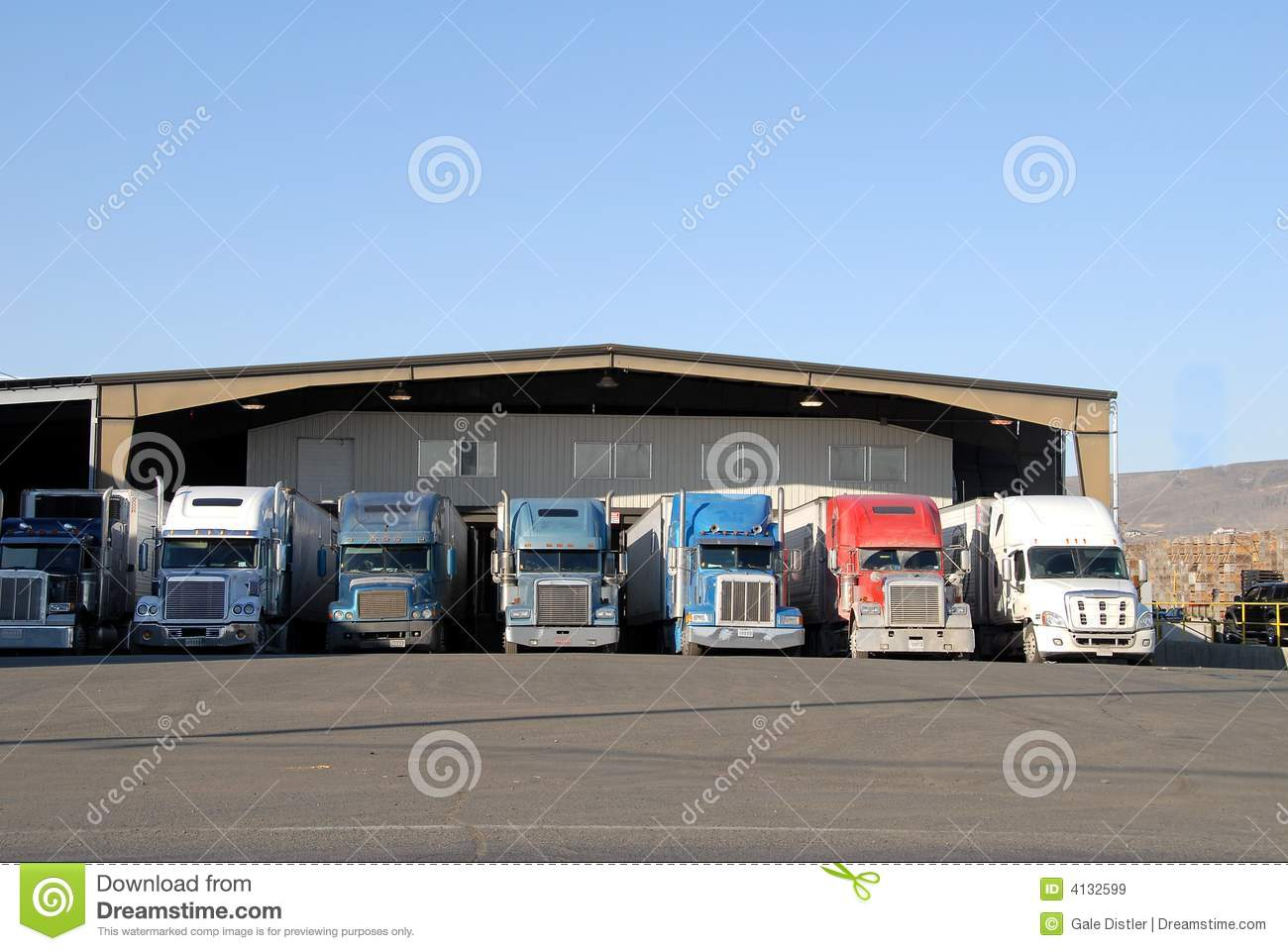 Seven Trucks At Warehouse Royalty Free Stock Images