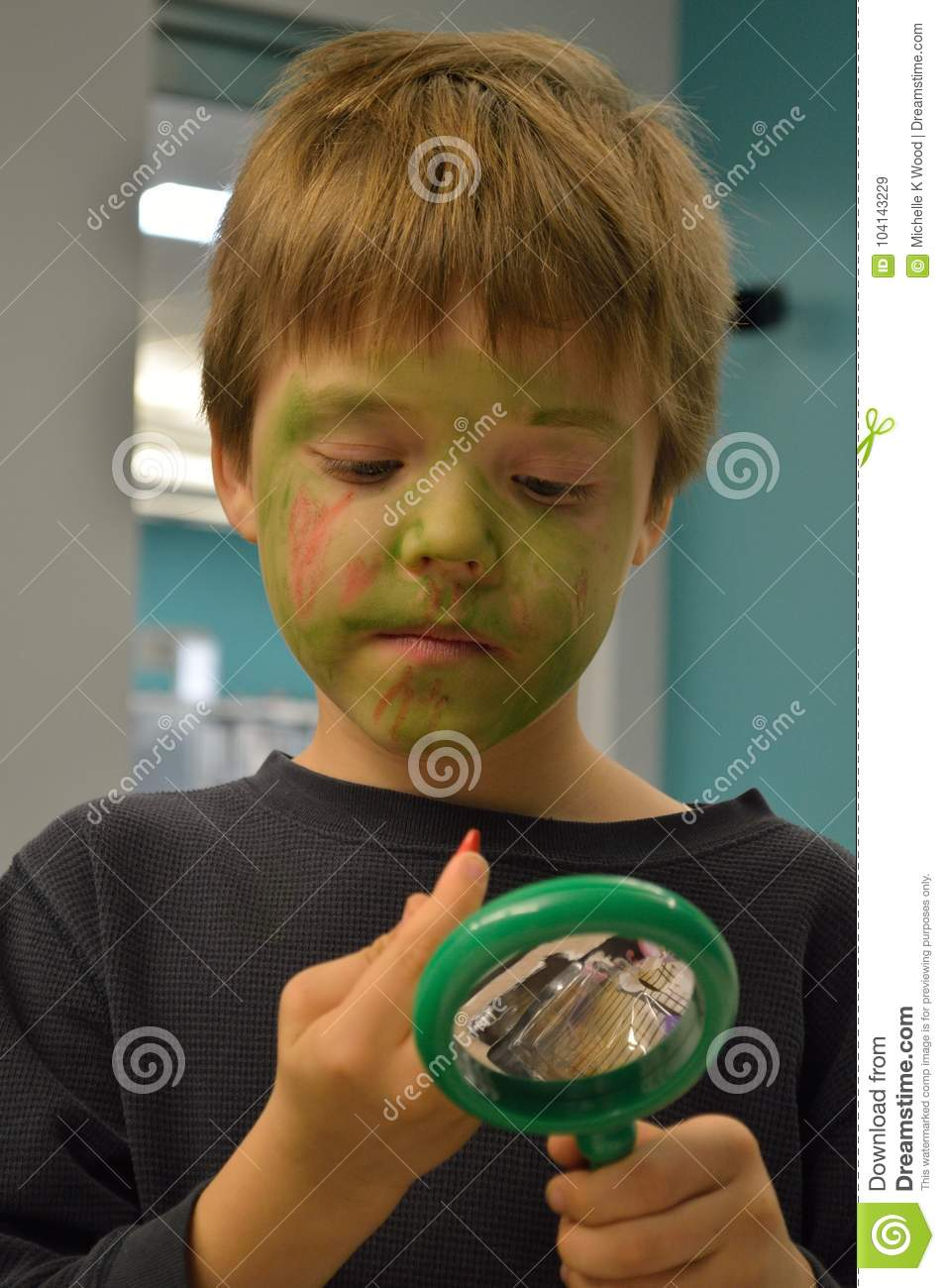 Boy painting Zombie face