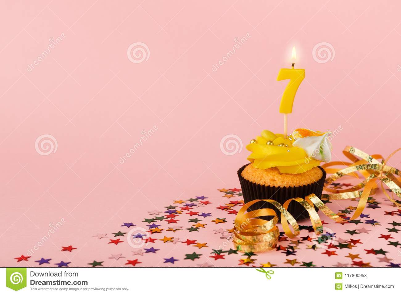 Seventh Birthday Cupcake With Candle And Sprinkles