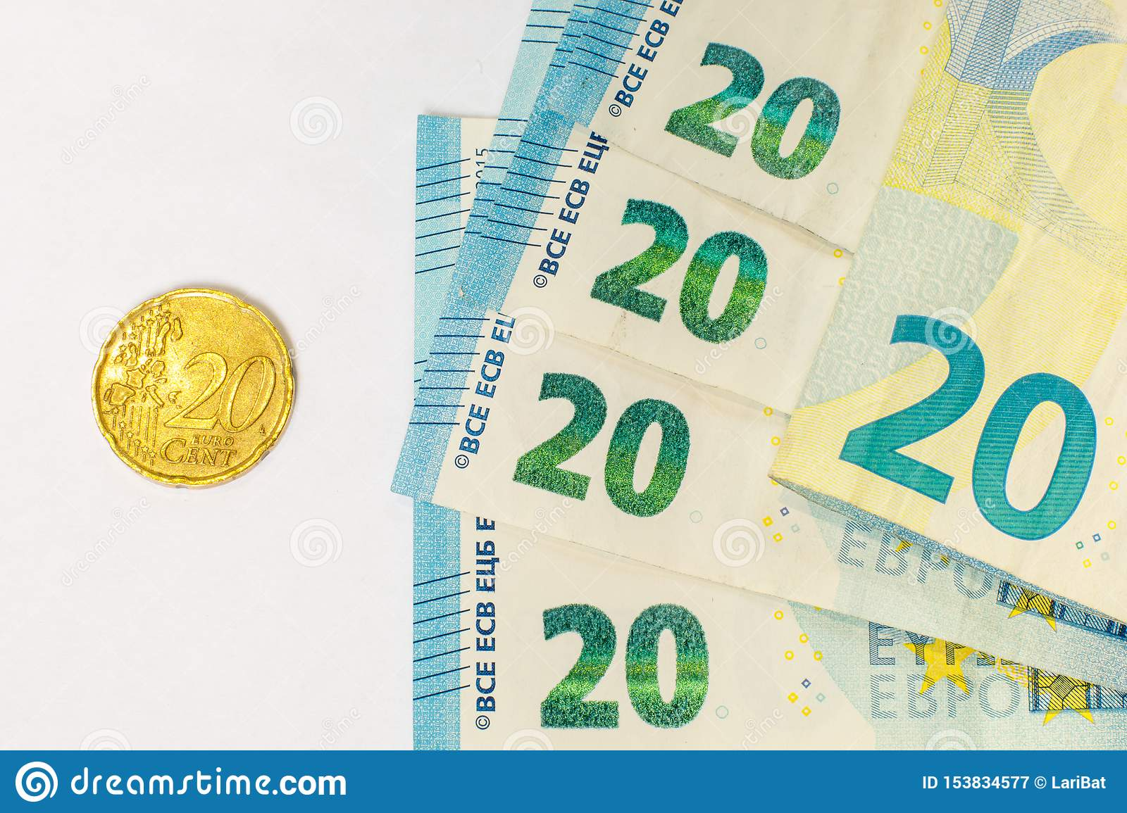 Several banknotes of 20 euros and a coin of 20 cents. The concept of opposing large and small earnings, saving or spending money
