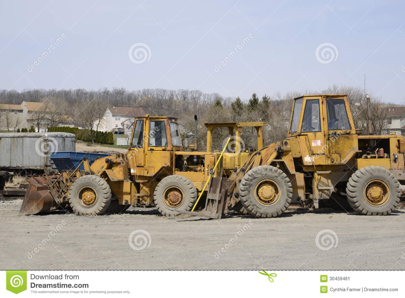 Several construction vehicles stock image of metal