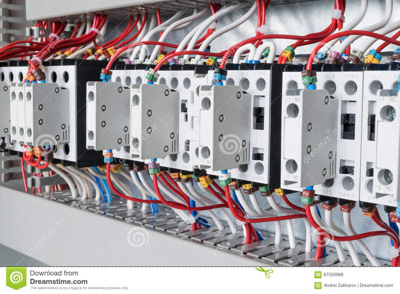 Several Contactors Arranged In A Row An Electrical Closet Stock Control Wiring Numbering System The Connected Wire Number Coded With Front Auxiliary Contacts Wires Go Into Perforated Cable Channels