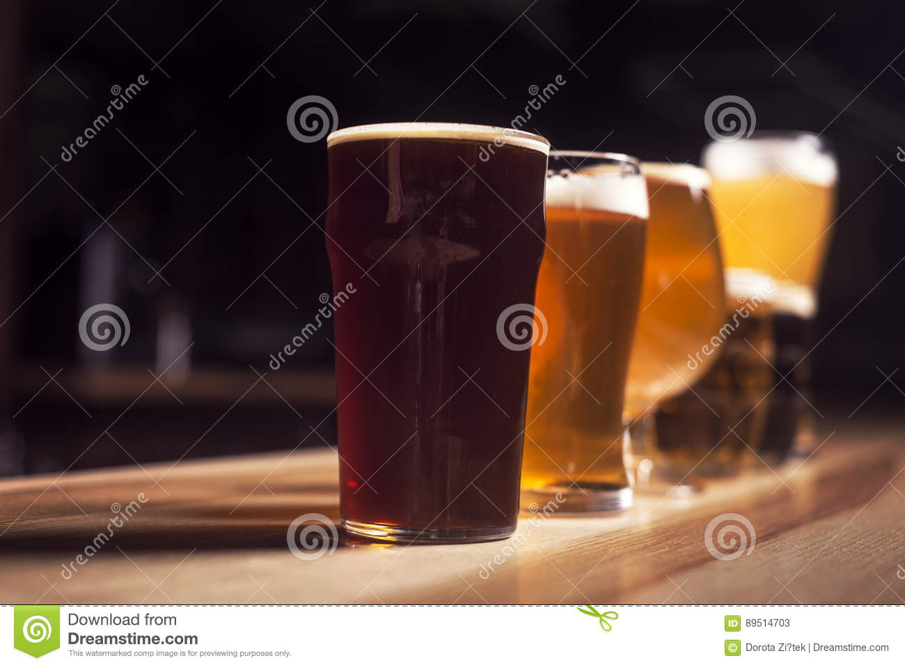 Several different beers are standing in a row