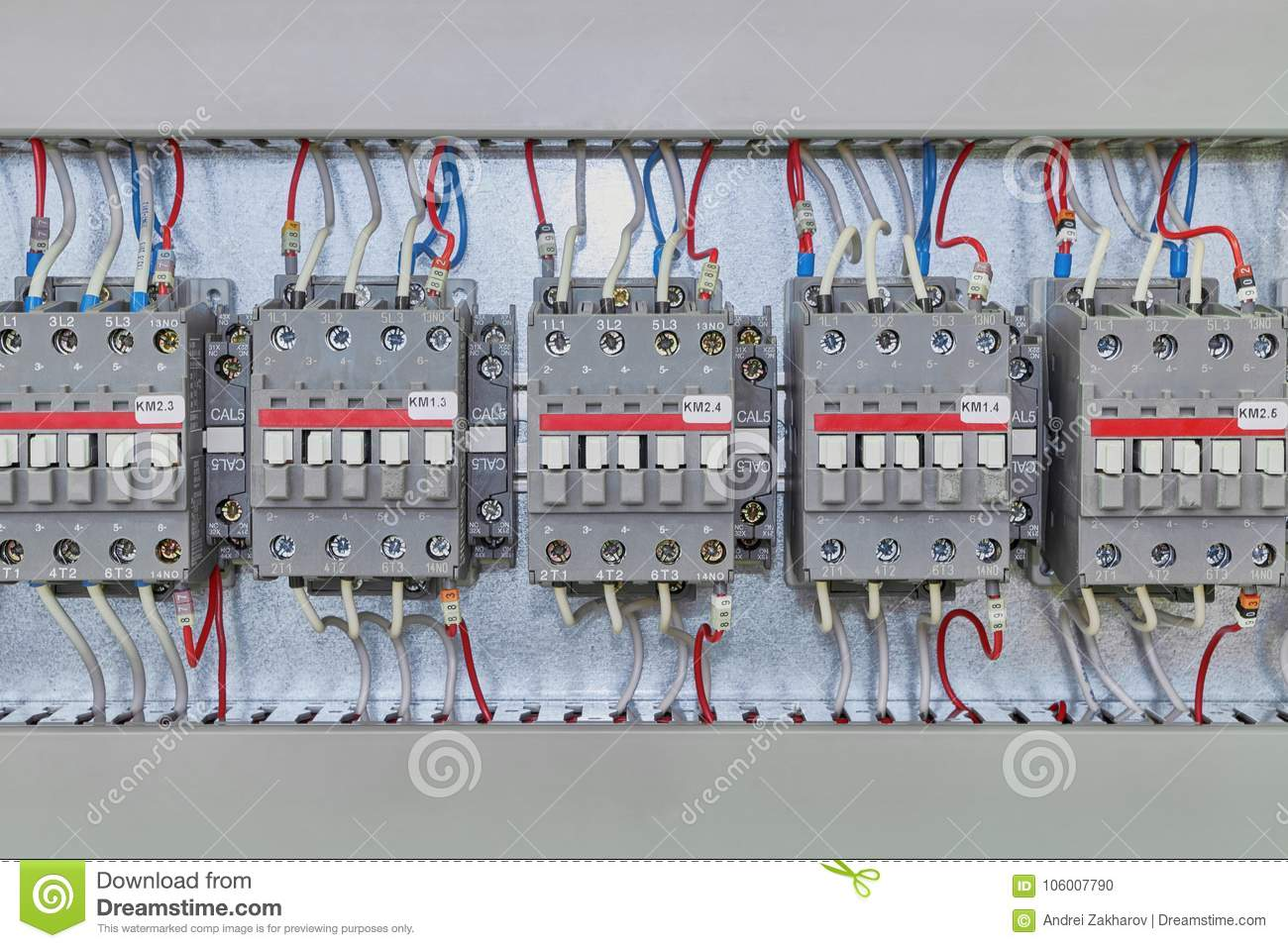 Several Electrical Contactor On A Mounting Panel In Electrical Closet.