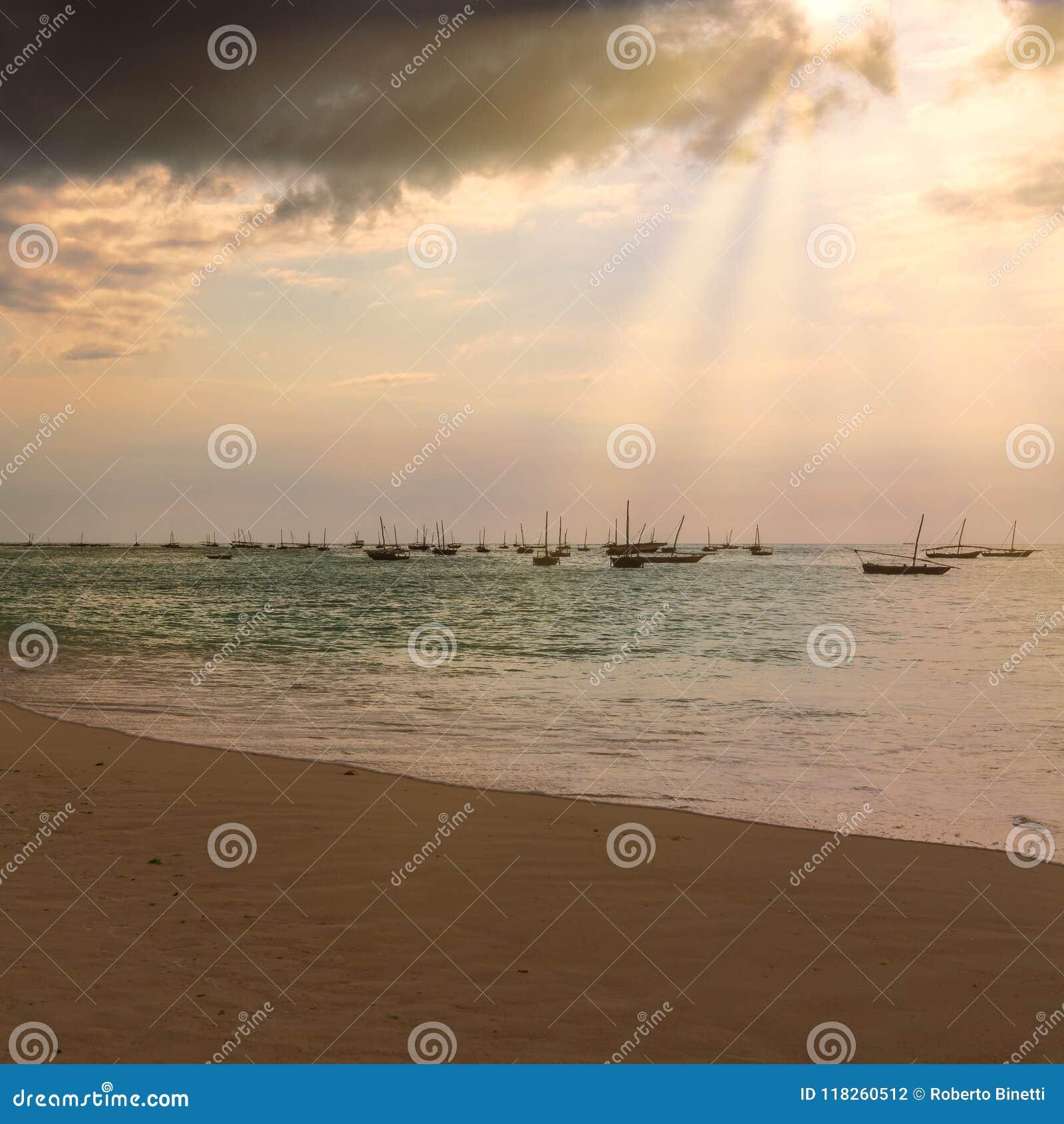 Several Fishing Boats Anchored At Sunset Stock Photo ...