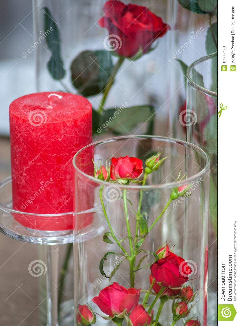 Several glasses of rose wine in the foreground, flowers, cakes and snacks at the festive table, rose, glass, holiday