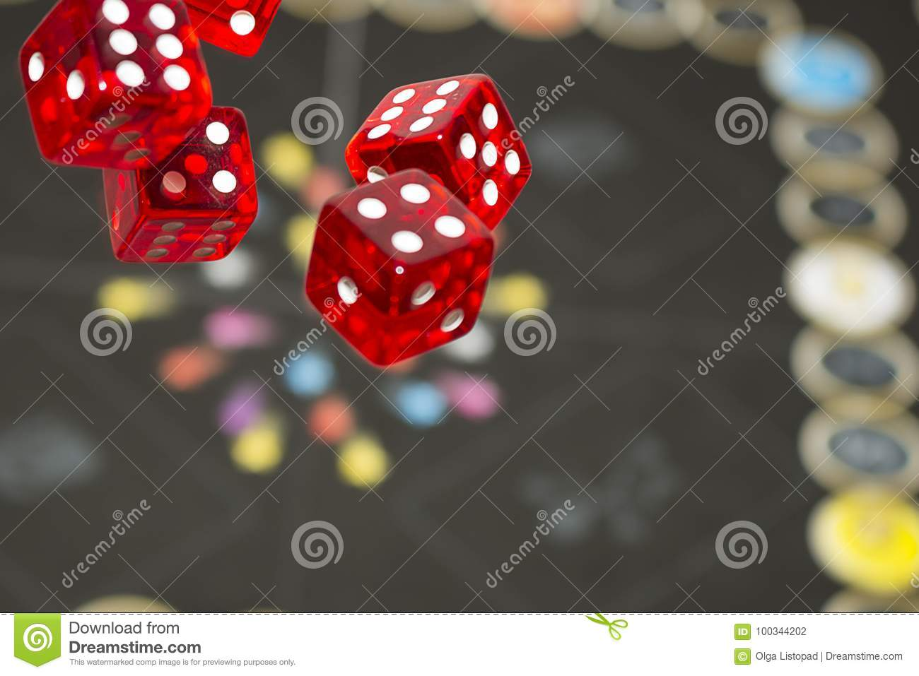 several rolling red dice fall on a table royaltyfree