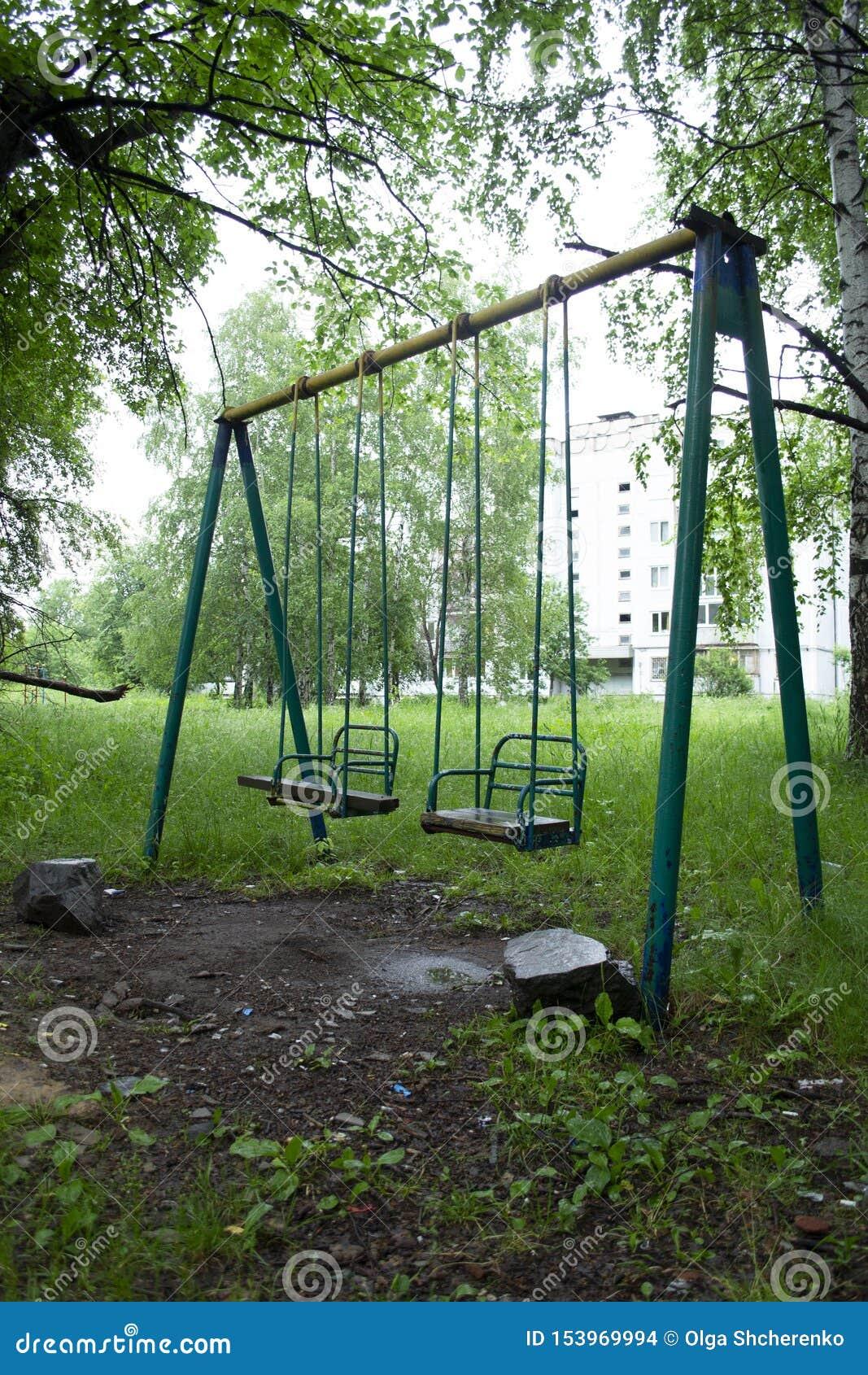 Severe Childhood Of Russian Children. Broken Swing In The ...