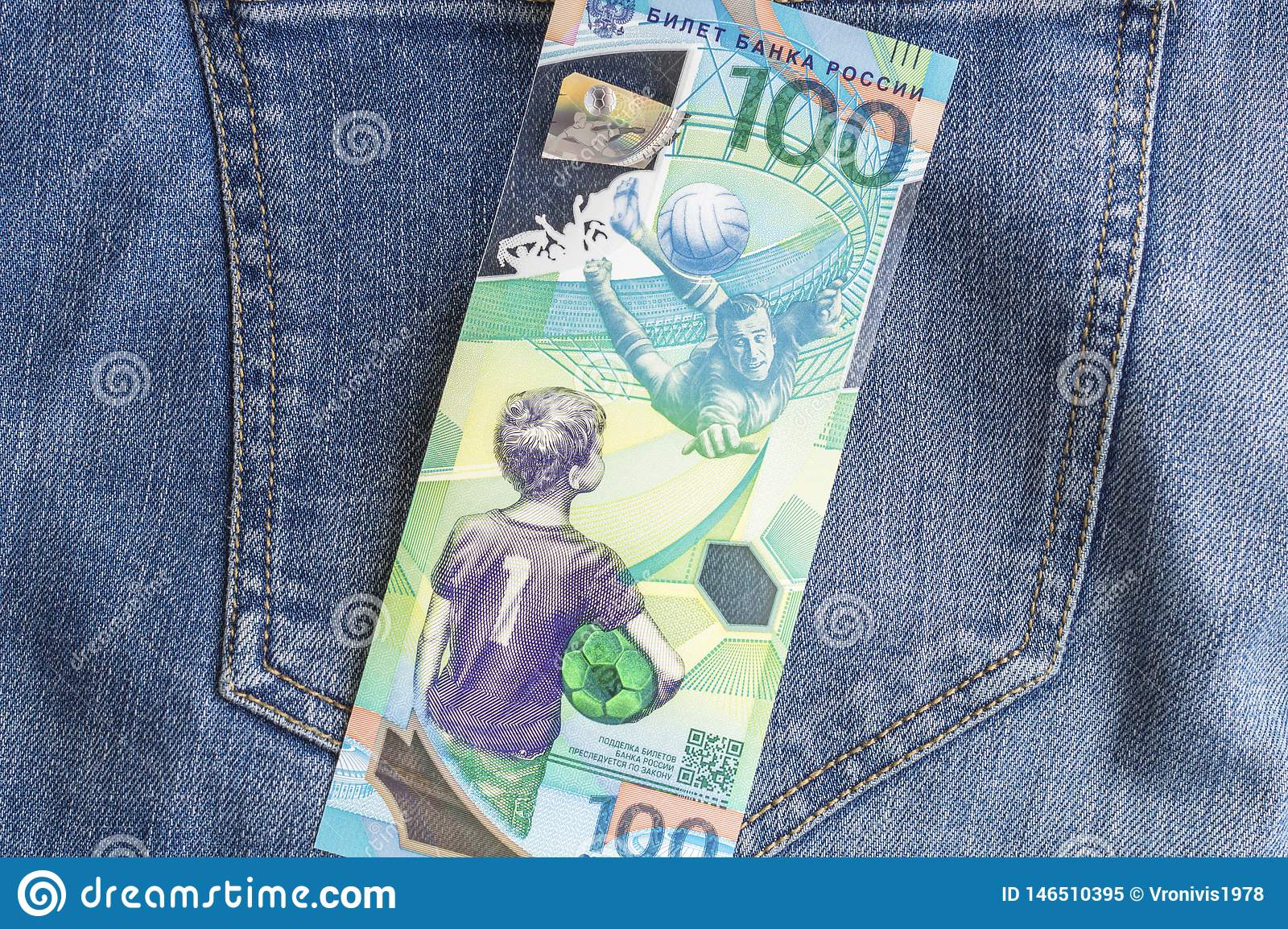 04.21.2019 Severodvinsk. Russia. Russian jubilee banknotes of FIFA 2018 soccer world cup 100 rubles on jeans background