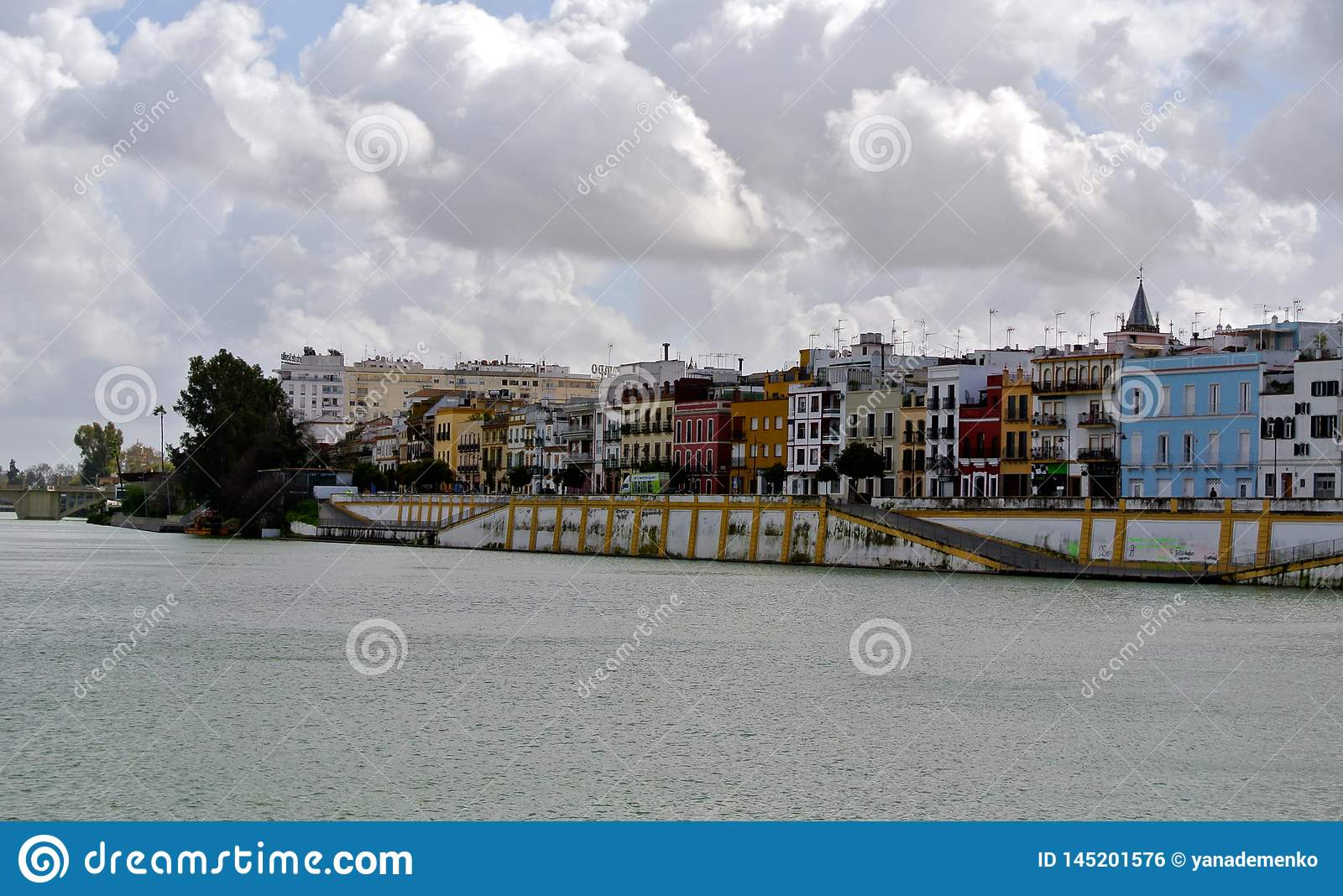 Heavy volumetric clouds over the Guadalquivir river line in Seville
