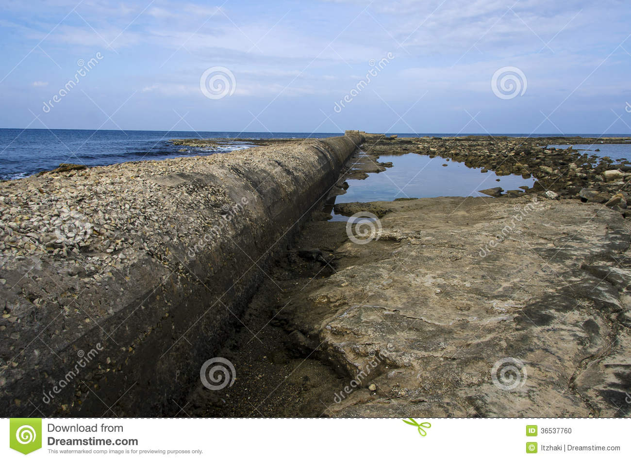 Sewage pipe having their outlet right into the sea stock photo sewage pipe having their outlet right into the sea sciox Images