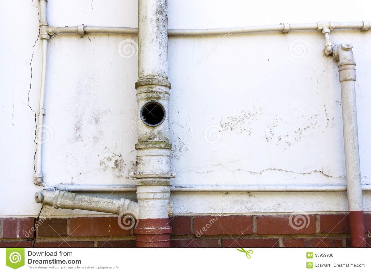 Sewage and water pipes on wall of residence stock photo for Water wall plumbing