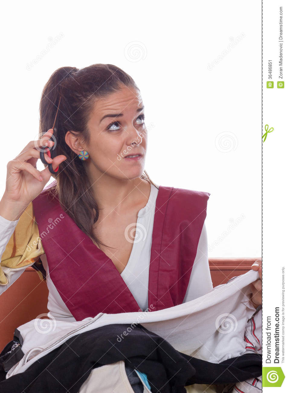 Woman With Scissors Wondering Stock Photography