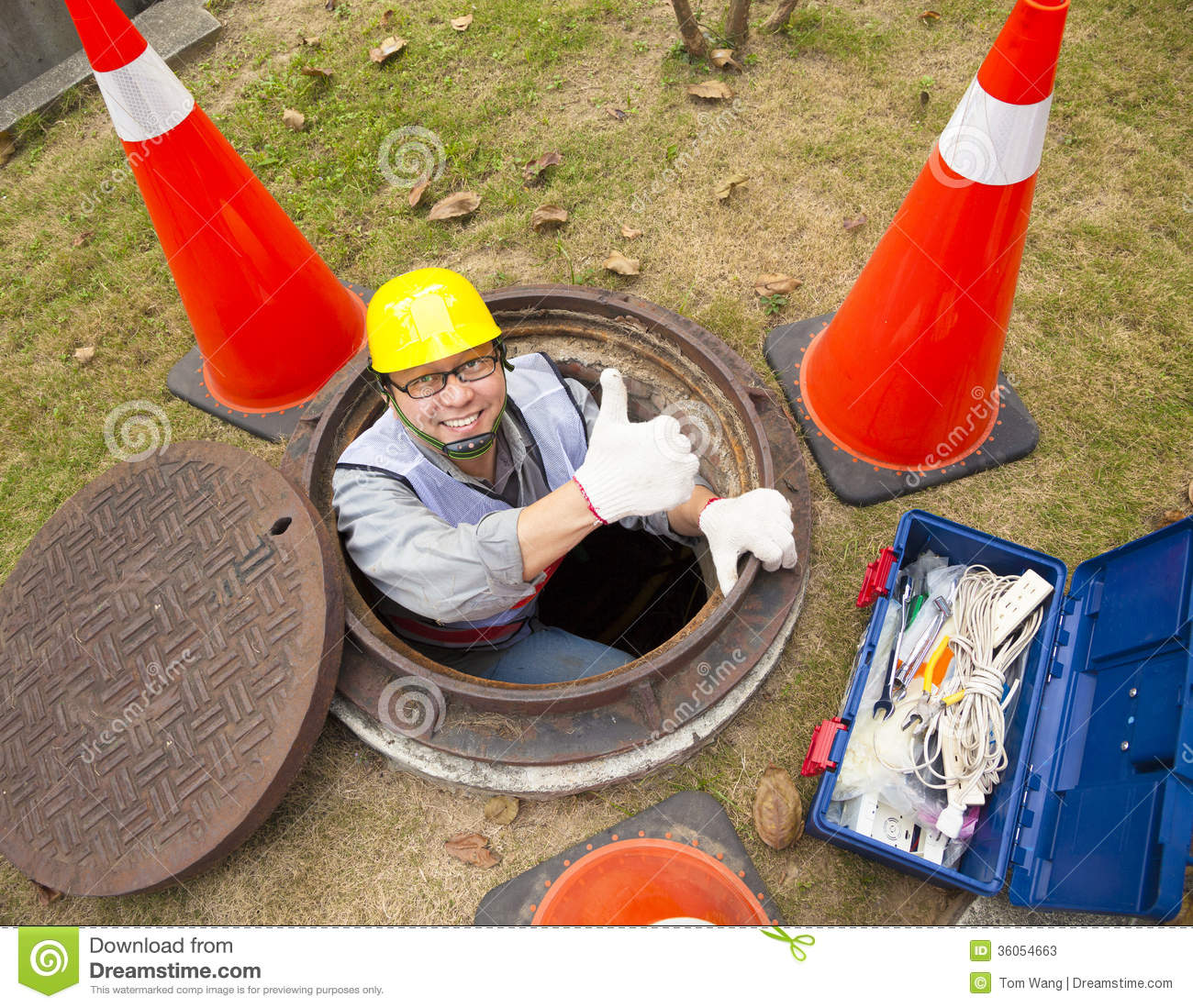 Sewerage worker in the manhole stock photos image