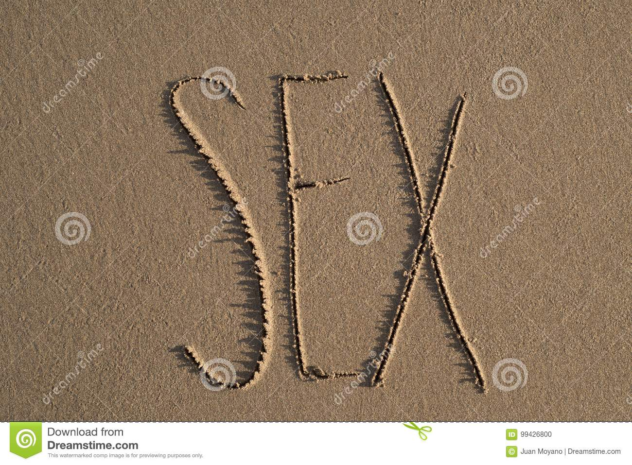 High-angle shot of the word sex written on the sand of a beach