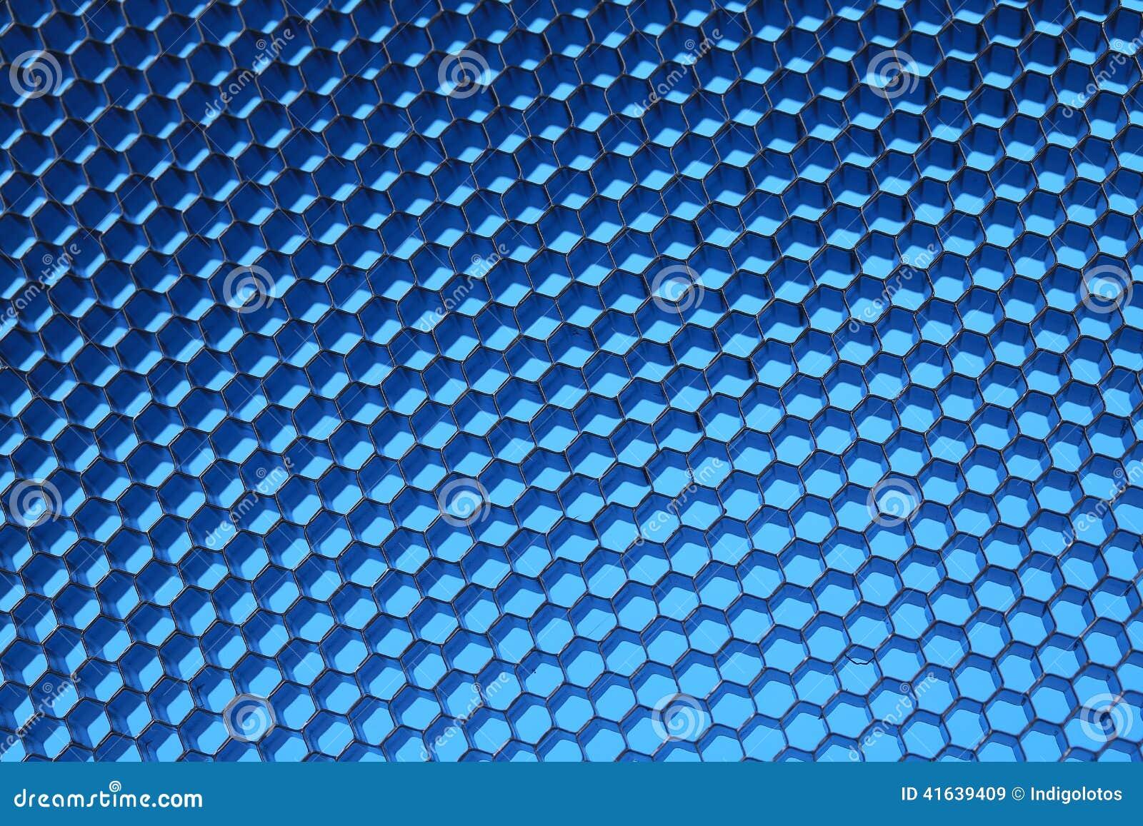 Sexhörnigt ingrepp på en blå bakgrund