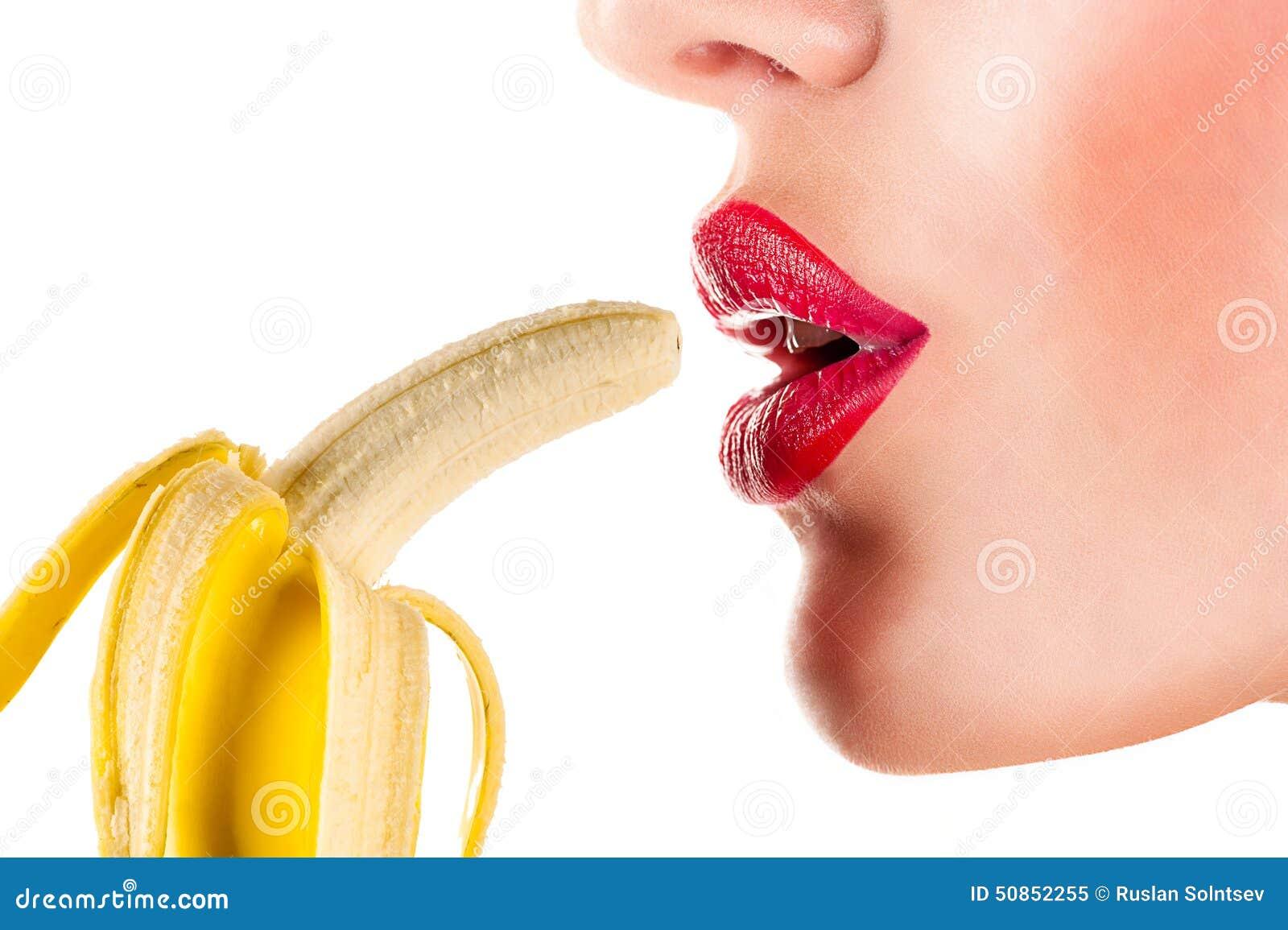 Sexig kvinna som äter bananen