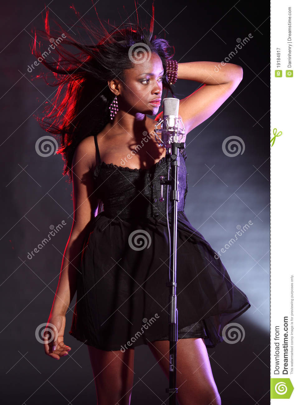 african american girl singing on stage