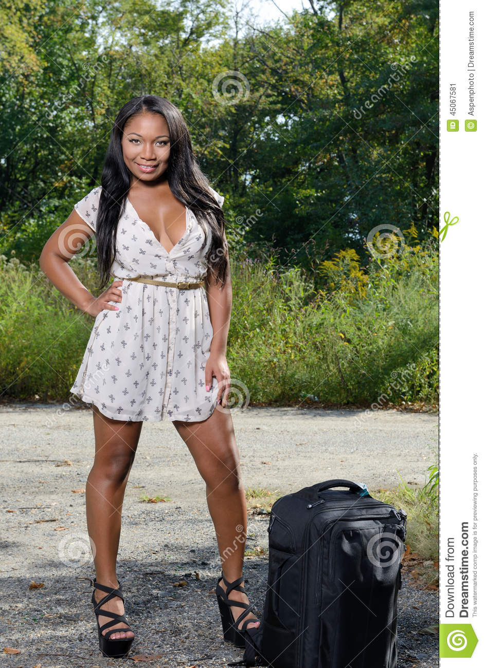 African American Woman In Sundress With Suitcase Travel