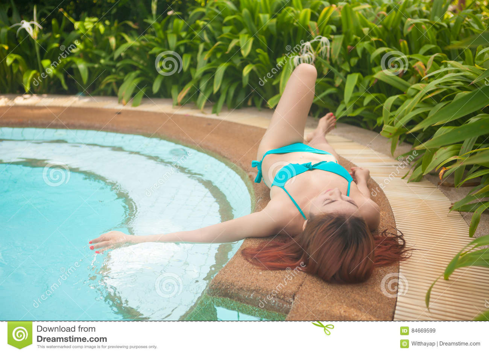Asian girl in blue bikini stock photo image 84669599 - Where is my nearest swimming pool ...
