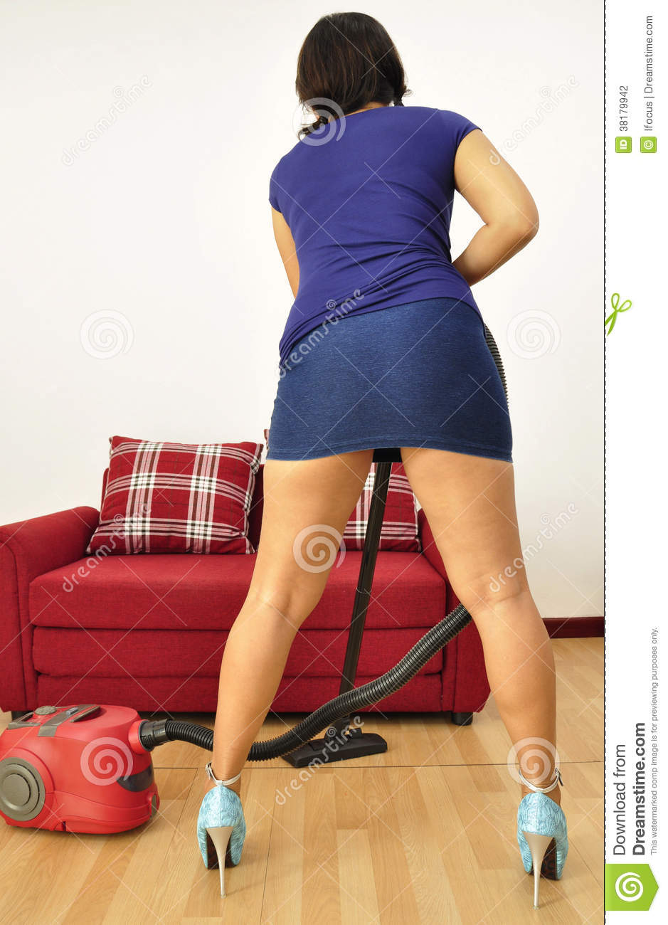 Sexy Asian Woman Short Skirt Vacuums Her Flat Stock Photography - Image: 38179942
