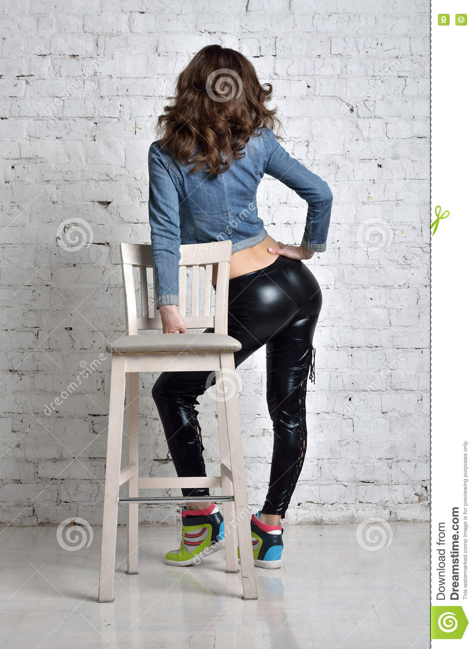 in black tights made of latex. stock image - image of jeans, tall