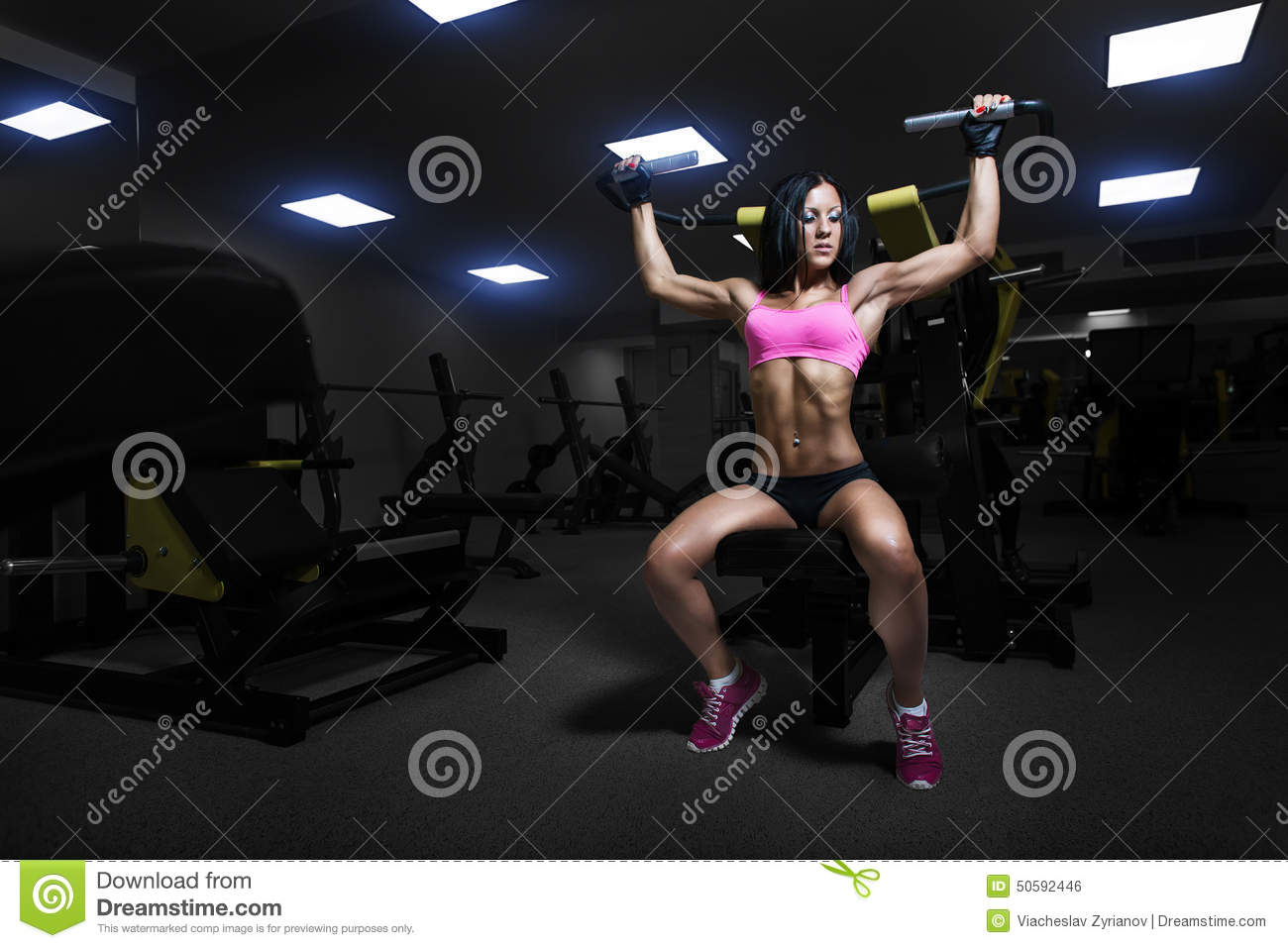 athlete woman lifts in the gym.