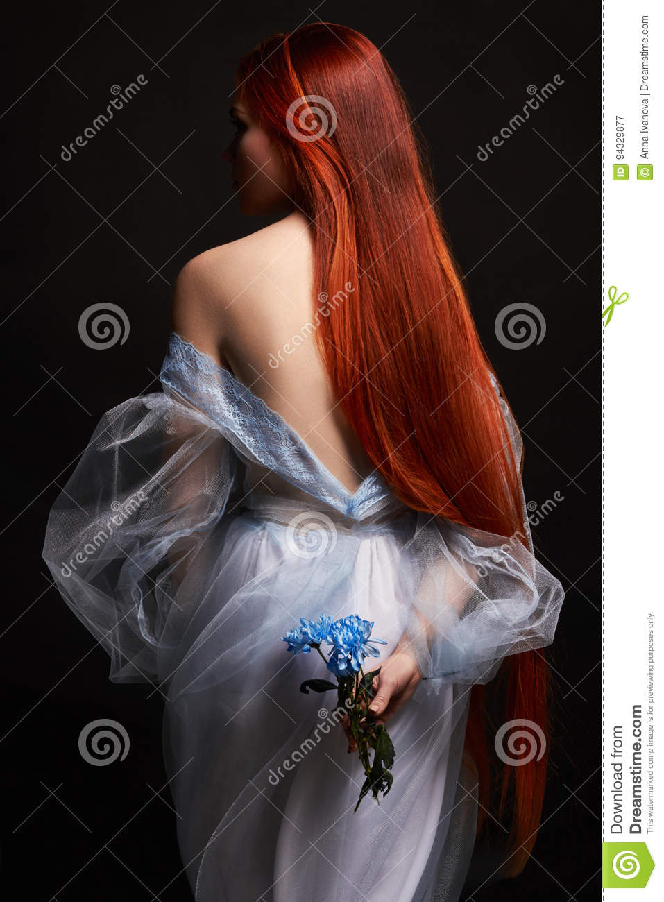 beautiful redhead girl with long hair in dress cotton retro. Woman portrait on black background. Deep eyes. Natural beauty