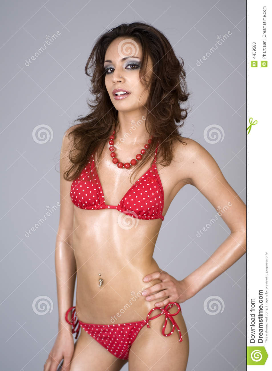 Portrait Of Woman Wearing Bikini Who Keeps Cut Of Orange